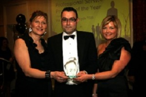 Dave Clapp (MD) and Lesley Garratt (Operations Director) from insureFLEET accepting the award from Heidi Cowen – Lloyds TSB