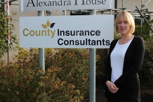 Jan Evans outside County Insurance's Head Office in Crewe, Cheshire